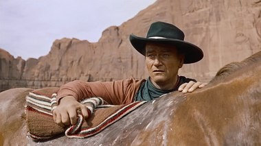 John Wayne, giving perhaps his best performance in 'The Searchers,' as a man alone, obsessed but unafraid.