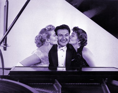 """""""I could get used to this!"""" Liberace flanked by Malone and Joanne Dru in """"Sincerely Yours."""""""