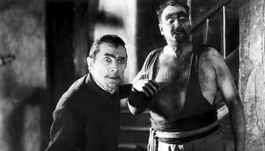 Bela Lugosi, left, as the villain of 'White Zombie,' Hollywood's firat real zombie movie