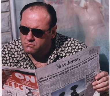 As Tony Soprano, reading The Star-Ledger.