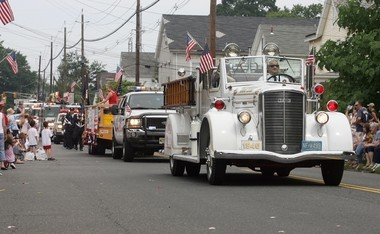 An antique fire truck at a Fourth of July parade in Milltown.