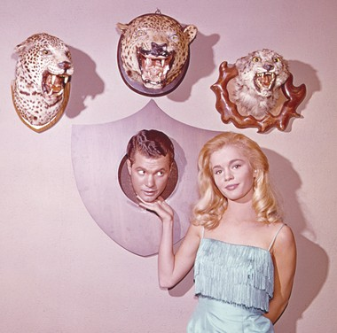 Hickman and Tuesday Weld in a pose that illustrates their characters' dynamic.