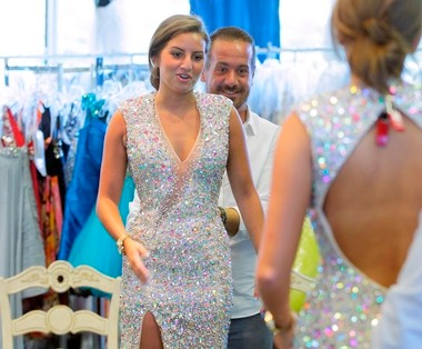 'We can't pinpoint why our girls win,' says Joshua Cody Grimes, sales manager at The Perfect Dress in Lawrence Township. 'But they do.' Jessica Citron, 21, daughter of the store's owner, models a pageant gown.