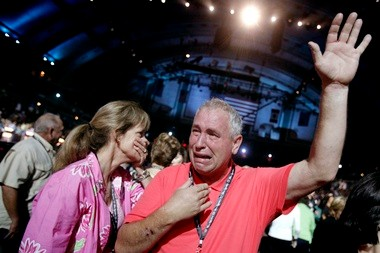 'Oh my God, oh Jesus, I'm so proud of her!' said an emotional Charles Jones, the father of Miss Florida Myrrhanda Jones, with his wife Lynn, left. Myrrhanda had just won the night's talent competition with her baton twirling performance. She performed with a knee brace and had to alter her routine because she tore an ACL ligament in one of her knees.
