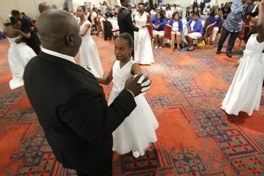Diamond Smith, 9, of Newark, dances during the Vashti School of Future Leaders Cotillion Ball for underprivileged girls held at The Robert Treat Hotel, Sunday, Oct. 13, 2013.