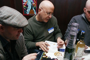 Pete Genovese considers a hot sauce at the Screaming Mi Mis.