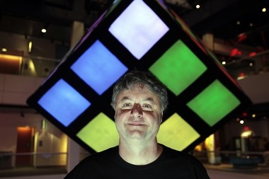 Paul Hoffman, CEO of Liberty Science Center, with a giant playable Rubik's cube, part of the 'Beyond Rubik's Cube' exhibit that opened there last month to celebrate the puzzle's 40th anniversary. Google is a partner in the display.