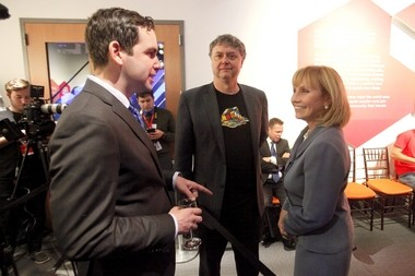 Hoffman, center, stands next to Jersey City Mayor Steven Fulop, left, and Lt. Gov. Kim Guadagno during a VIP reception for the opening of 'Beyond Rubik's Cube'. The science center CEO-writer-restaurateur calls himself 'guest-centric.'