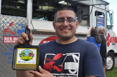 George Prado, manager of Red Hook Lobster Pound, with the Top Truck award.