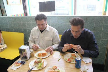 Jason and Justin Senft try the sandwiches at Big Stash's in Kearny.