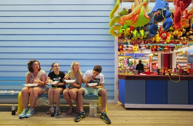 Munchers enjoy takeout from Park Seafood on the Seaside Heights boardwalk.
