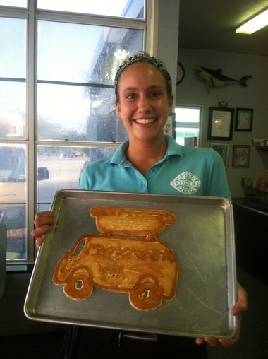 Waitress Julia Beekman shows off the Munchmobile pancake made by Mustache Bill Diner owner Bill Smith.