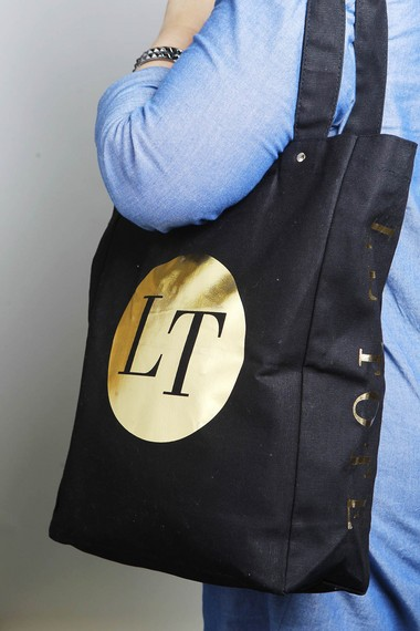 The author models a bangle bracelet and tote bag included in her first shipment from Le Tote, a monthly fashion subscription service.