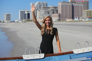 Miss America 2015, Kira Kazantsev, in a pageant tradition, walked out on the beach this morning outside Boardwalk Hall to dip her feet in the Atlantic Ocean. (Alex Remnick | NJ Advance Media for NJ.com)
