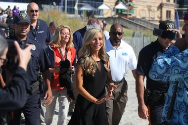 Kazantsev leads a crush of photographers, pageant-watchers and security to the ocean to say hello to Atlantic City, her new 'home.' (Alex Remnick | NJ Advance Media for NJ.com)
