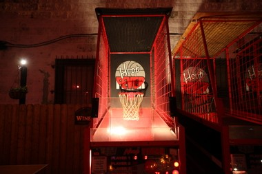 Basketball arcade games outside at Johnny Mac's House of Spirits in Asbury Park.
