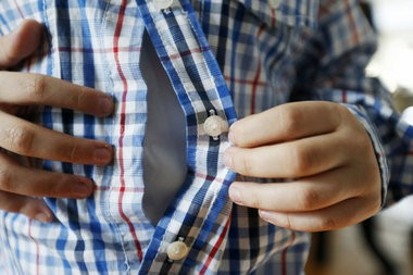 Magnets are placed under the button and on the other side of the shirt inside a seam. Adaptive clothing has made it possible for Oliver Scheier, who has muscular dystrophy, to dress himself. (Ed Murray   NJ Advance Media for NJ.com)