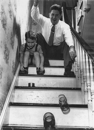 Slinky inventor Richard James, at right, with his son, Tom, testing out their stair-walking technique. (Courtesy Tom James)