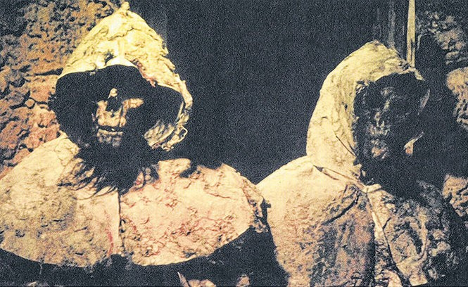 """Zombie emerge from a musty tomb in the Spanish horror film """"The Blind Dead"""" (1972)."""