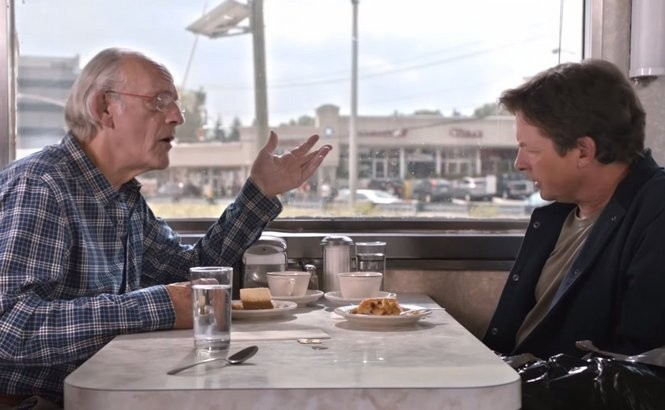 Christopher Lloyd and Michael J. Fox talk technology in the Bendix Diner in Hasbrouck Heights. (Toyota/YouTube)