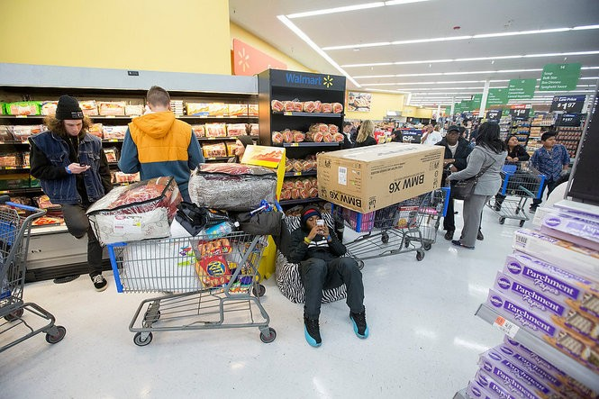 Keenan Sylvester, 17, lines up to wait for a 32-inch Samsung TV to go on sale inside the Wal-Mart in Brick Township on Thanksgiving as part of a Black Friday deal. (Andrew Mills | NJ Advance Media for NJ.com)