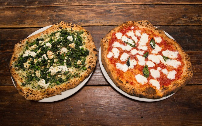 A Winter Betty pizza, left, with goat cheese, homemade ricotta, broccoli rabe pesto, roasted garlic, thyme, chile flakes, extra virgin olive oil, and the Margherita, with San Marzano tomatoes, fresh mozzarella, parmigiano reggiano, basil, extra virgin olive oil, taken at Porta Asbury Park, but also offered at Porta Jersey City. (Cathy Miller)