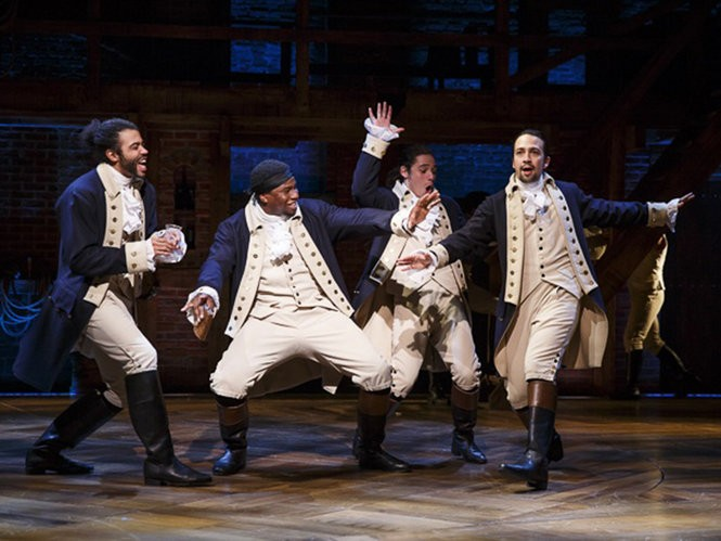 """Okieriete Onaodowan, second from left, as Hercules Mulligan in """"Hamilton,"""" with Daveed Diggs as Marquis de Lafayette, left, Anthony Ramos as John Laurens, second from right, and Lin-Manuel Miranda as Alexander Hamilton."""