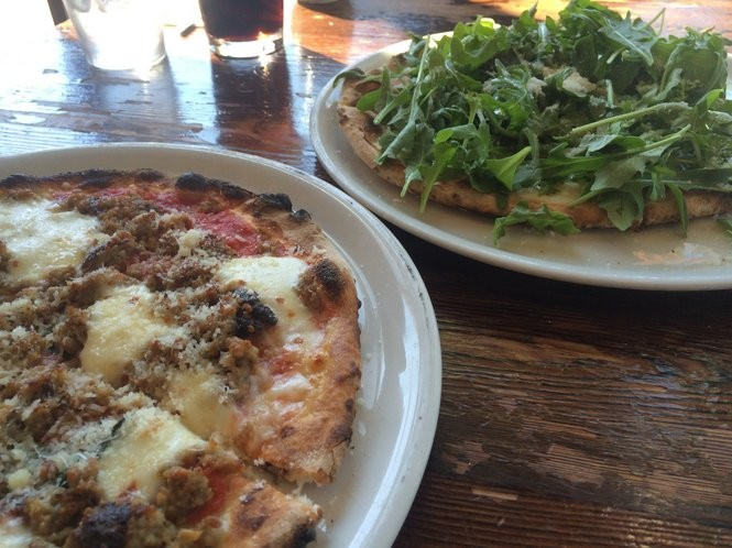 Bianco pizza with arugula and salsiccia pizza from Ah' Pizz on June 10, 2016. (Sydney Shaw | NJ Advance Media for NJ.com)