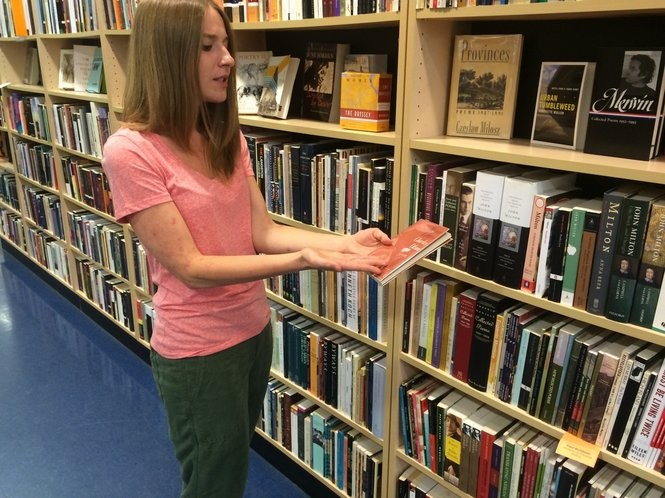 Book seller Alison Thompson shares information about a book from the poetry section of Labyrinth Books. (Sydney Shaw | NJ Advance Media for NJ.com)