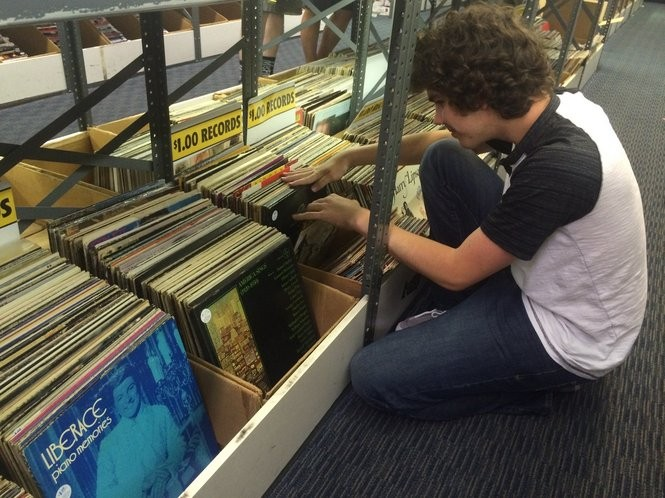 Michael Melchiondo, an employee at Princeton Record Exchange, browses one of the store's dollar bins. (Sydney Shaw | NJ Advance Media for NJ.com)