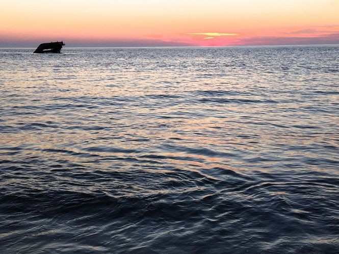 Each night at Cape May Point, visitors gather to watch the sun disappear intothe Atlantic Ocean.