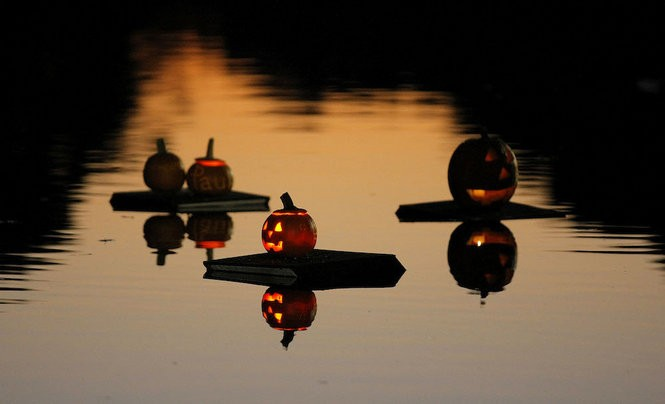 Pumpkins float in Echo Lake during the Great Pumpkin Sail in Echo Lake Park. Every year locals launch their jack-o'-lanterns onto the water the day after Halloween. (John Munson/The Star-Ledger)