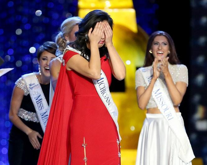 Arianna Quan reacts after winning the talent award on the third night of Miss America preliminaries at Boardwalk Hall. (Tim Hawk | For NJ.com)