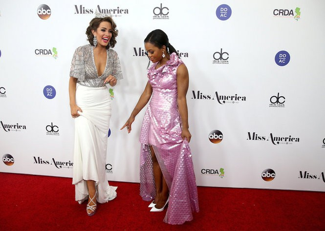 Miss America 2016, Betty Cantrell, at left, talks with Olympic gymnast and judge Gabby Douglas on the red carpet before the 2017 Miss America competition at Boardwalk Hall in Atlantic City. (Tim Hawk | For NJ.com)