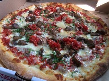 The tasty Campanaccio pizza, with wild mushrooms, sausage, filetto tomato and parsley, at Nicoletta in Bernardsville (Peter Genovese I NJ Advance Media for NJ.com)