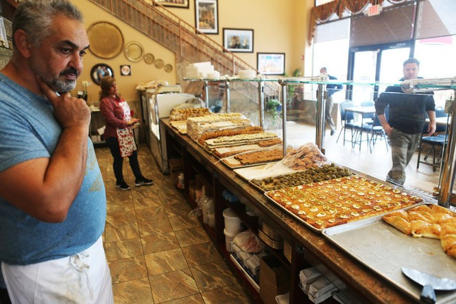 Owner Abdullah Abedrabbo stands inside Nablus Sweets, a recently expanded Middle Eastern pastry shop on Main Street, the center of the Middle Eastern enclave in South Paterson.