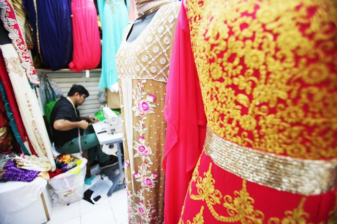 Ajay Dari works at the sewing machine inside Silk Heritage, a shop on Oak Tree Road in the Iselin section of Woodbridge Township, an area known as 'Little India.'
