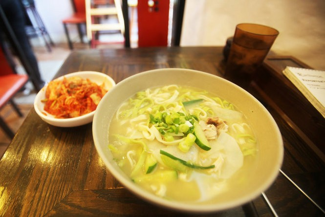 A bowl of chicken kalguksu, a Korean dish of broth, meat, vegetables and homemade, knife-cut noodles served at Son Kalguksu, a restaurant on Broad Avenue in Palisades Park, NJ, an area often referred to as 'Koreatown.'