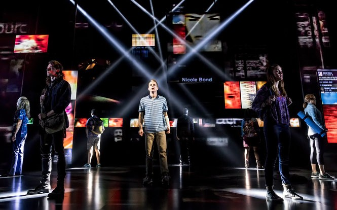 """The set for """"Dear Evan Hansen"""" consists of video screens with social media scrolls flashing on them throughout the show (Photo by Matthew Murphy)"""
