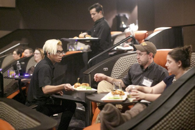 "A ""ninja server"" serves food to audience members in the premium plus seats. (Aristide Economopoulos 