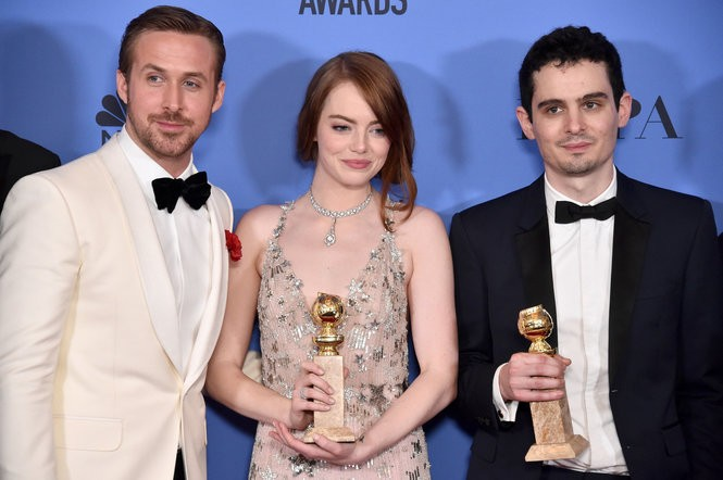 Ryan Gosling, Emma Stone and Damien Chazelle at the 2017 Golden Globe Awards, where 'La La Land' scooped up honors for best motion picture musical, actor, actress, director and screenplay. (Alberto E. Rodriguez/Getty Images)