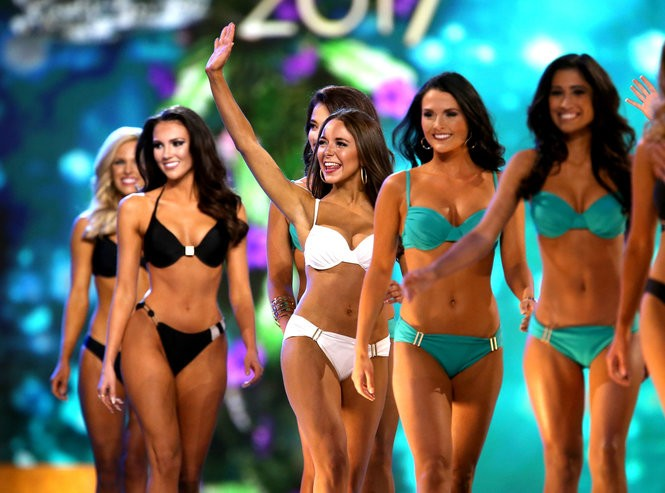 Contestants walk the stage in the swimsuit portion of the 2017 Miss America preliminary competition at Boardwalk Hall in Atlantic City. (Tim Hawk | For NJ.com)