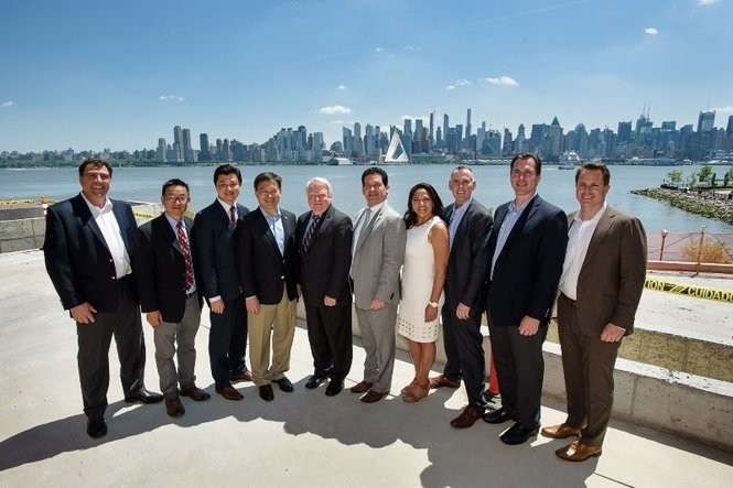Weehawken Mayor Richard Turner (middle) stands with developers from Landsea, who are building the luxury housing complex, Avora. (Cahn Communications)