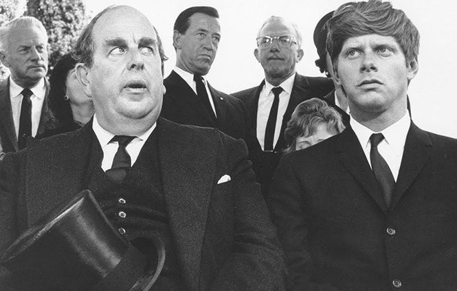"Robert Morley, left, and Robert Morse attend an extravagant funeral in ""The Loved One"" (1965)."