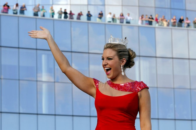 Mallory Hagan, Miss America 2013, waves to people on her float at the Miss America Show Us Your Shoes Parade in September 2013. In emails to staff, Sam Haskell, pageant CEO, called Hagan 'huge' and 'gross,' insulting her appearance. (Aristide Economopoulos/The Star-Ledger)