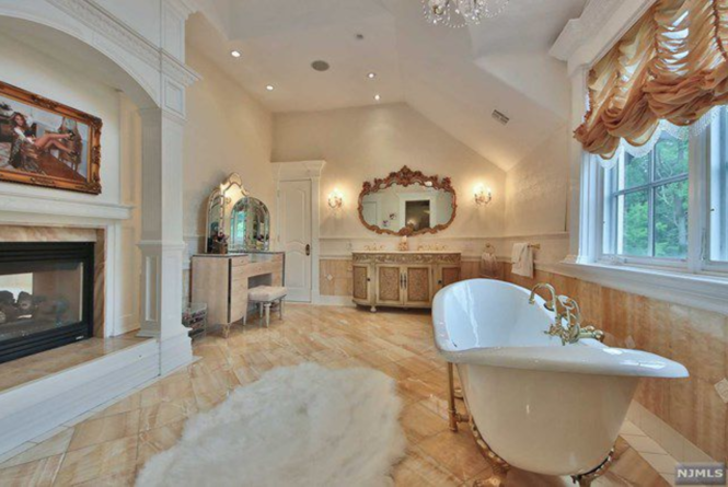 The master bathroom in Melissa Gorga's Montville home. Yes, that appears to be a portrait of her above the fireplace. (Trulia)