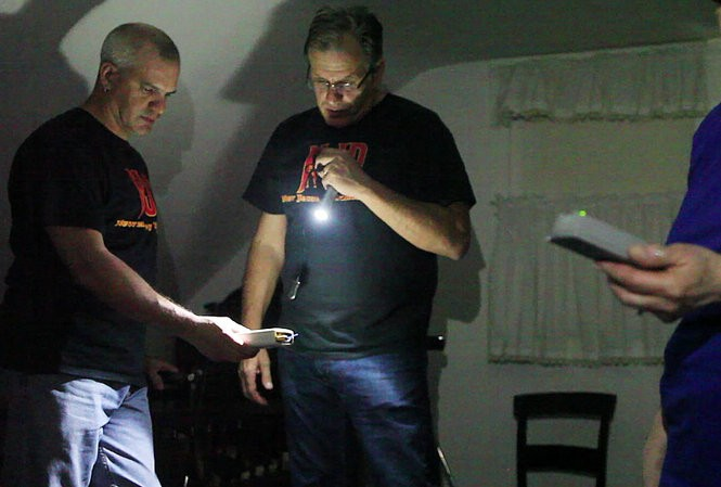 John DiMattico and Barry Ruggiero investigate energy in a third floor room at the Caldwell Parsonage House in Union. (Frances Micklow | The Star-Ledger)