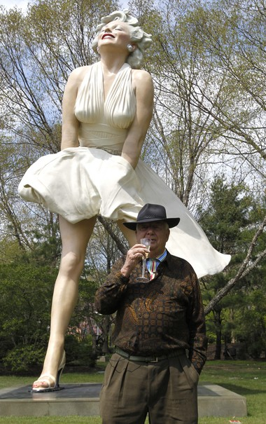 """Seward Johnson raises his glass to toast """"Forever Marilyn"""" at the sculpture's unveiling Friday."""