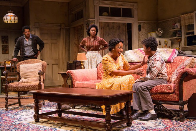 Brandon J. Dirden (Walter Lee Younger), Crystal A. Dickinson (Ruth Younger), Brenda Pressley (Lena Younger) and Owen Tabaka (Travis Younger) in A Raisin in the Sun at Two River Theater in Red Bank. (T Charles Erickson)