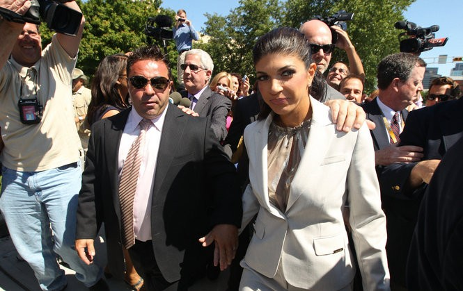 """""""Real Housewives of New Jersey"""" stars Joe and Teresa Giudice leave the federal courthouse in Newark after being charged with bank fraud, bankruptcy fraud and conspiracy to commit mail and wire fraud in 2013."""
